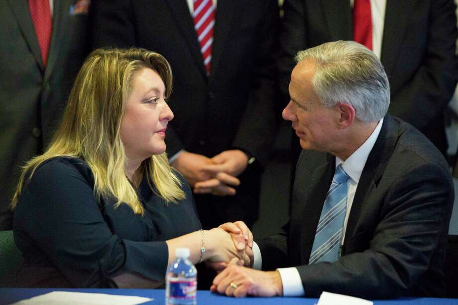Gov. Greg Abbott shakes hands with Toni McKinley,  a sex trafficking survivor after announcing a $40 million plan that would bring significant change to state criminal laws regarding sex crimes and trafficking. Photo: Marie D. De Jesus / © 2018 Marie D. De Jesus
