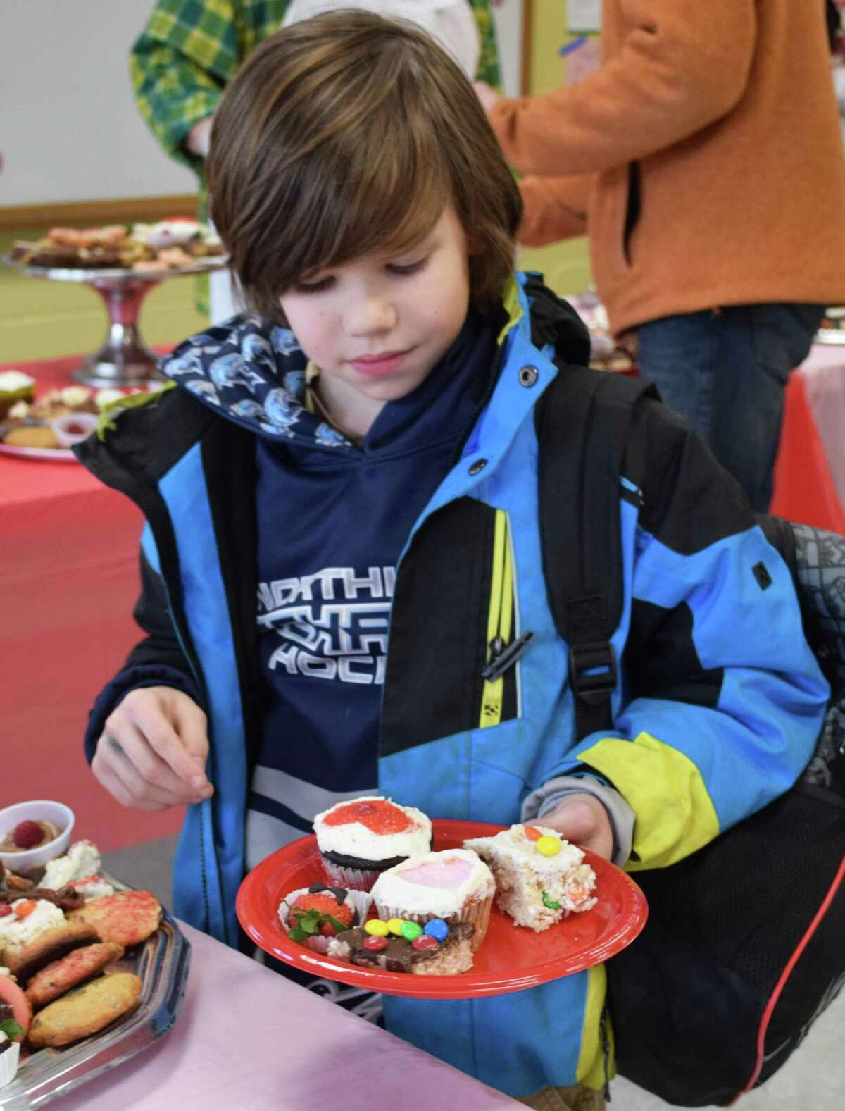 Spectrum/As first in line at the Kent Center School's Scholarship Fund's 23rd annual Chocolate Fest, Chase Harrington, who turned 10 Feb. 10, 2018, appears pleased with his selection of treats at the FEb. 8, 2018 event.