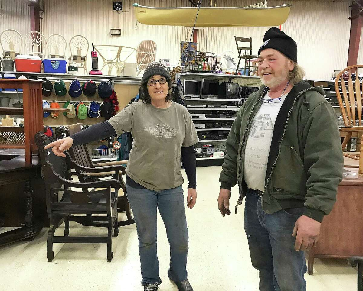 Dawn and Mert Larmore, owners of Litchfield County Pickers, talk about some of their merchandise at their new location in New Milford on Friday.