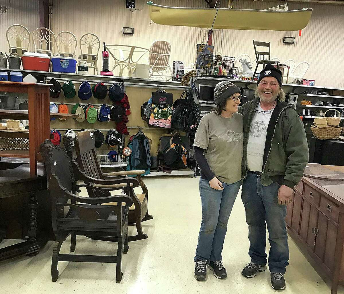 Dawn and Mert Larmore, owners of Litchfield County Pickers, stand in their new location in New Milford, Conn., on Friday, Feb. 9, 2018.