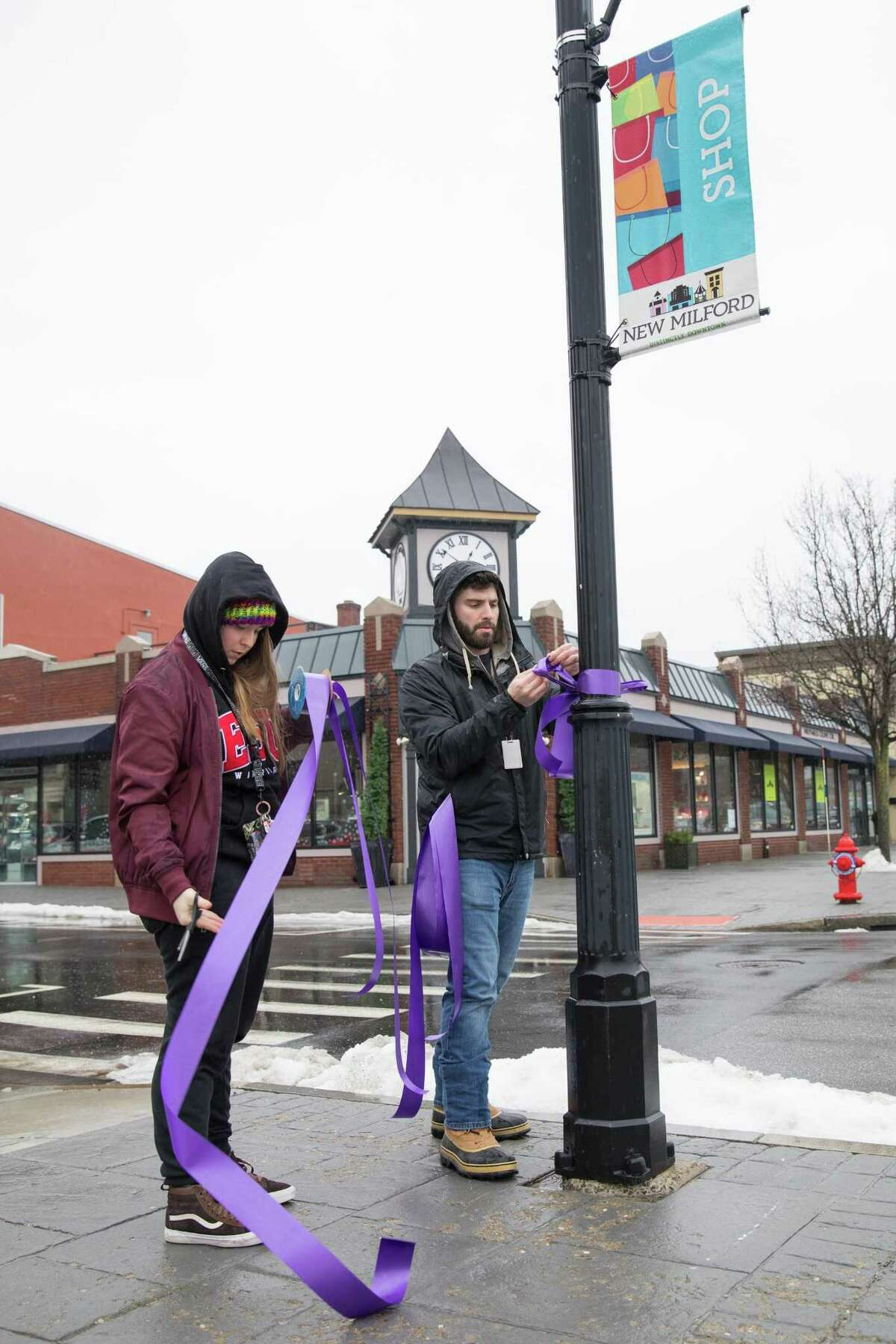 Above, Reginarose Ryan, age 15, and Tori DeJulia, age 16, both from S.A.D.D. (Students Against Destructive Decisions) participated in The Project Purple group (with the Housatonic Valley Coalition Against Substance Abuse) by decorating the Village Green with purple ribbons to raise awareness. Right, Carly Brill, age 17, S.A.D.D. President and Jason O'Connor, a Youth Advocate from the New Milford Youth Agency, particpating in the event.