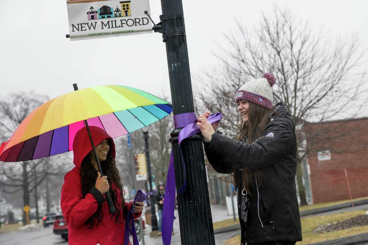 Reginarose Ryan, 15, and Tori DeJulia, 16, both from Students Against Destructive Decisions, participated in the Project Purple group with the Housatonic Valley Coalition Against Substance Abuse by decorating the Village Green with purple ribbons to raise awareness.