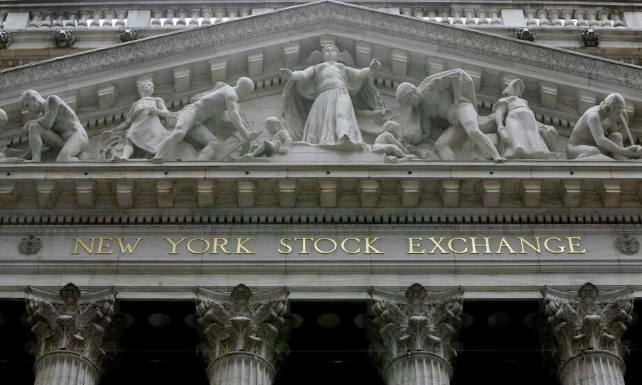 FILE - This Oct. 4, 2014, file photo, shows the facade of the New York Stock Exchange. Health care companies are leading stocks broadly lower in early trading Tuesday, Feb. 13, 2018, on Wall Street as the market gives back some of its big gain from the day before. (AP Photo/Richard Drew, File) Photo: Richard Drew, STF / Copyright 2016 The Associated Press. All rights reserved. This material may not be published, broadcast, rewritten or redistribu