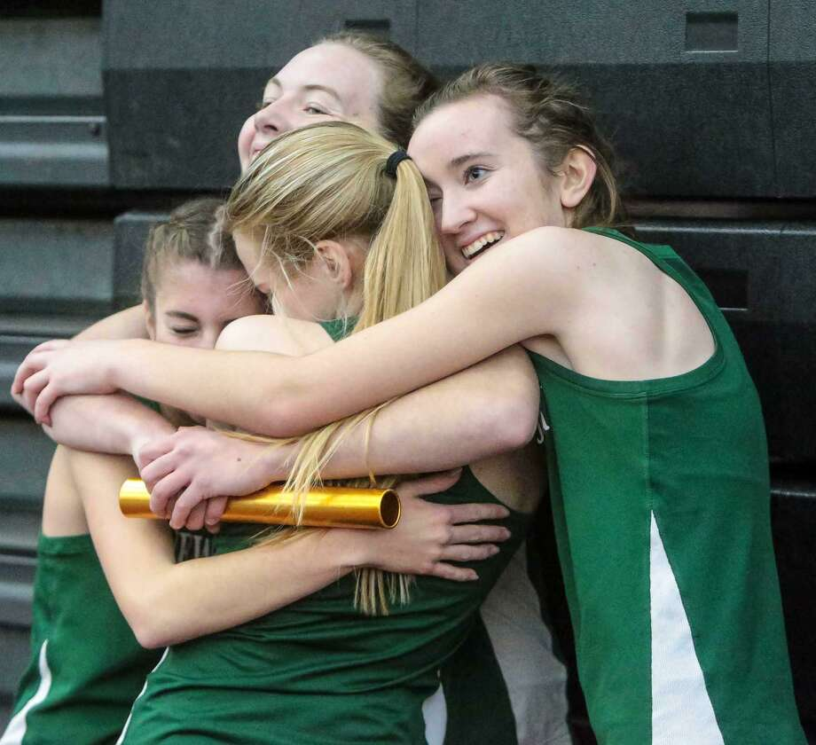 Above, the New Milford Girls 4x800 meter relay team celebrate their CIAC Class L state title in New Haven on Thursday. The relay team is Sarah Grudzwick, Darcy Cook, Julia Quinn and Brooke Morabito. At right, New Milford's Darcy Cook outruns Mercy's Madison Webster to claim 4th place in the CIAC  Class L State championship. Photo: John H Vanacore / Hearst Connecticut Media / (c)John H.Vanacore
