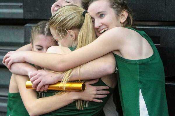 Above, the New Milford Girls 4x800 meter relay team celebrate their CIAC Class L state title in New Haven on Thursday. The relay team is Sarah Grudzwick, Darcy Cook, Julia Quinn and Brooke Morabito. At right, New Milford's Darcy Cook outruns Mercy's Madison Webster to claim 4th place in the CIAC  Class L State championship.