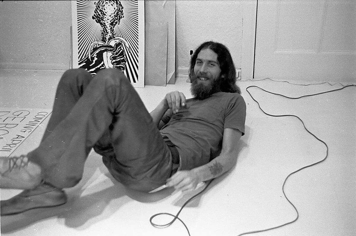 Gut, lounging in front of John Van Hamersveld�s Atomic Banana. Gut used John�sphotograph of Blue Cheer in designing the band�s first album,