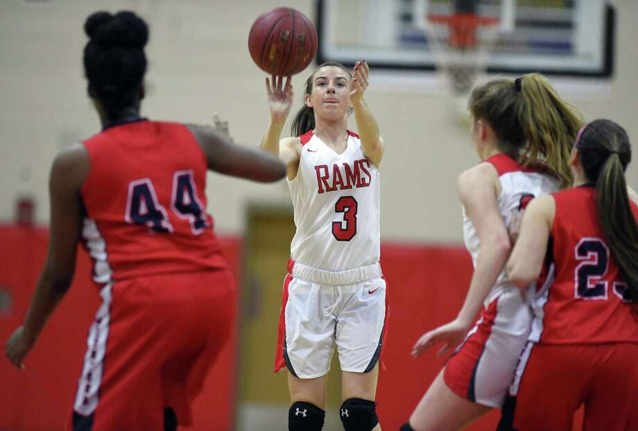 New Canaan's Maeve Selvaggi (3) puts up a shot against Brein McMahon Aija Andrews (44) during an FCIAC Girls Basketball game at New Canaan High School on Tuesday, Feb. 13, 2018 in New Canaan, Connecticut. New Canaan defeated Brein McMahon 40-27. Photo: Matthew Brown / Hearst Connecticut Media / Stamford Advocate