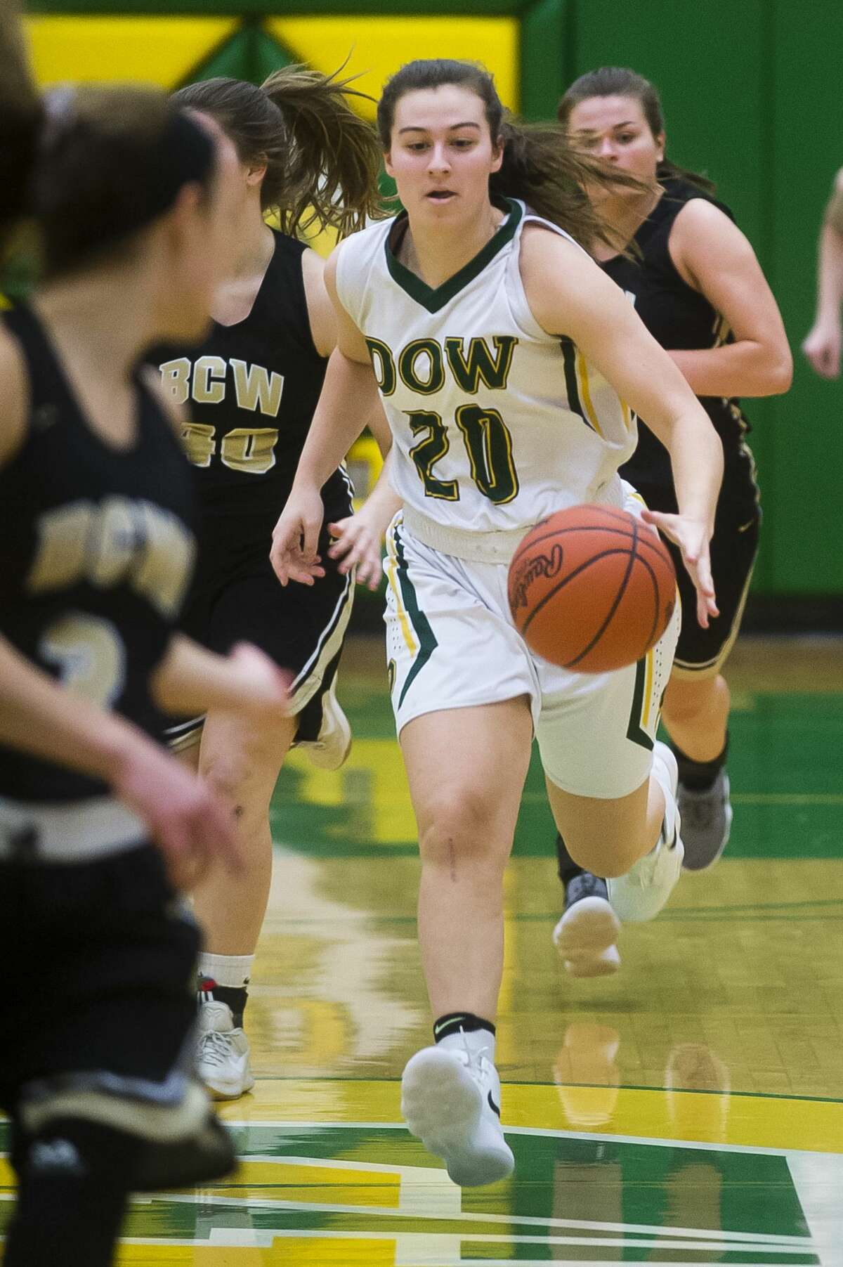 Dow junior Maizie Taylor dribbles down the court during the Chargers' game against Bay City Western on Tuesday, Feb. 13, 2018 at H. H. Dow High School. (Katy Kildee/kkildee@mdn.net)