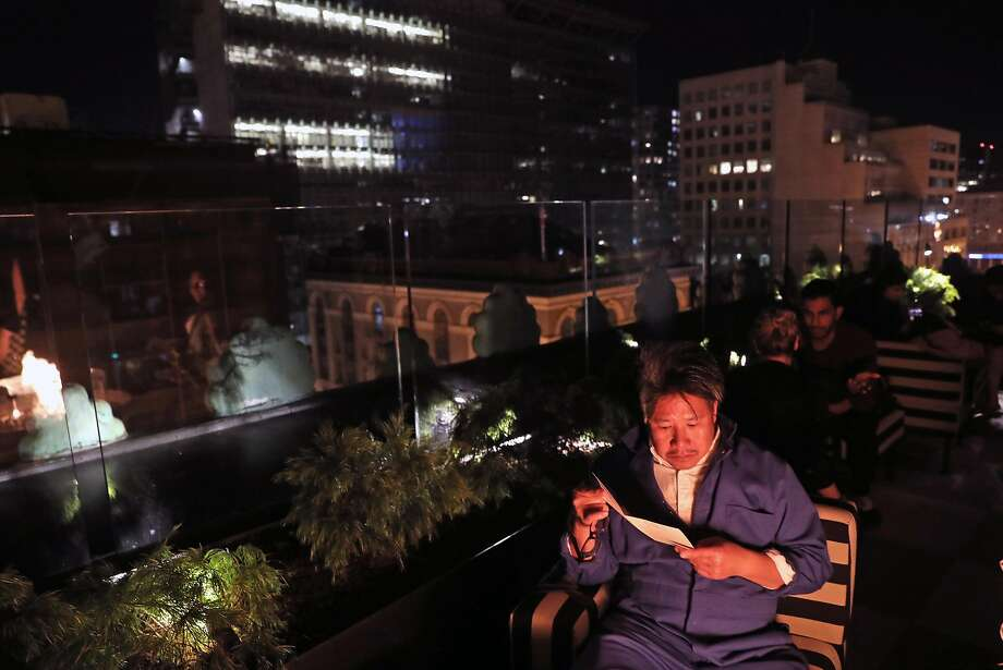 Architect Kulapat Yantrasast, from top, on his way to Kin Khao for dinner; a cocktail with the meal; at the Proper Hotel's roof-top bar. Photo: Scott Strazzante, The Chronicle