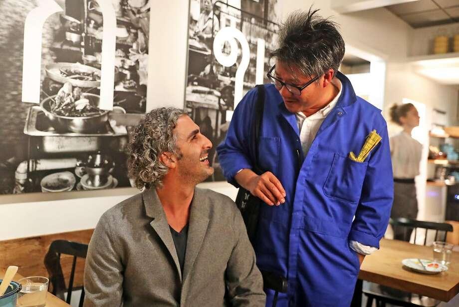 Architect Kulapat Yantrasast visits with Canopy co-founder Amir Mortazavi at Kin Khao. Photo: Scott Strazzante, The Chronicle