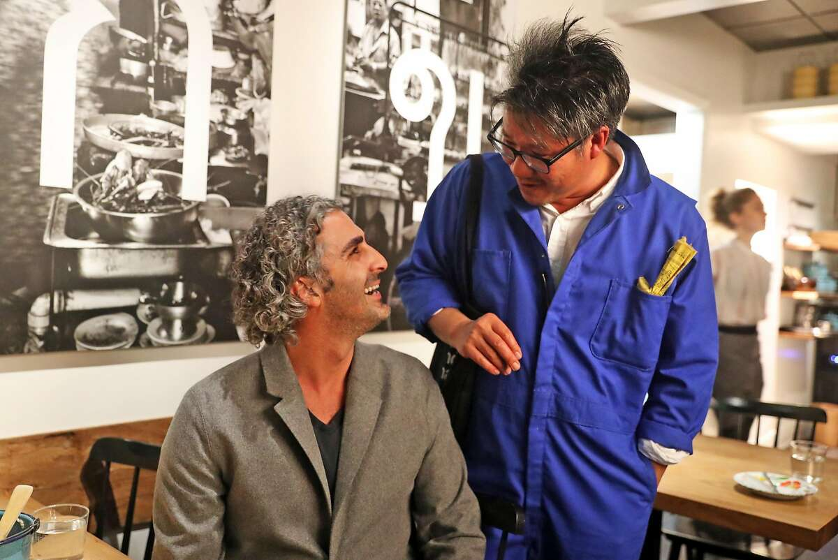 Architect Kulapat Yantrasast visits with Canopy co-founder Amir Mortazavi at Kin Khao in San Francisco, Calif., on Thursday, February 1, 2018.