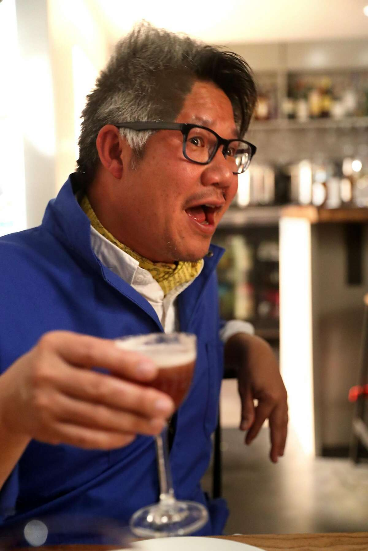Architect Kulapat Yantrasast enjoys dinner at Kin Khao in San Francisco, Calif., on Thursday, February 1, 2018.