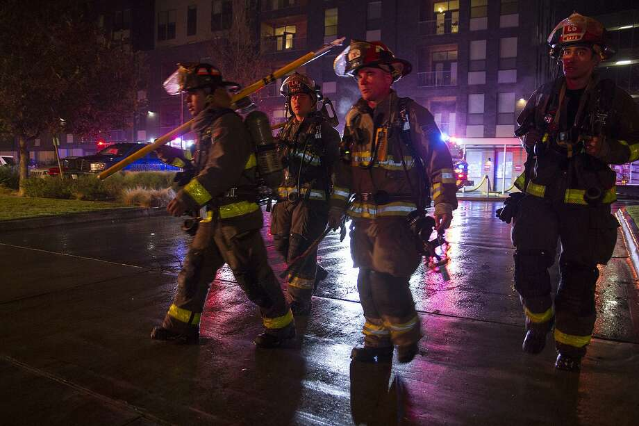 San Antonio firefighters outside the Agave Apartments on St. Mary's street in December of 2016. Photo: Alma E. Hernandez, For The San Antonio Express News / Alma E. Hernandez / For The San Antonio Express News