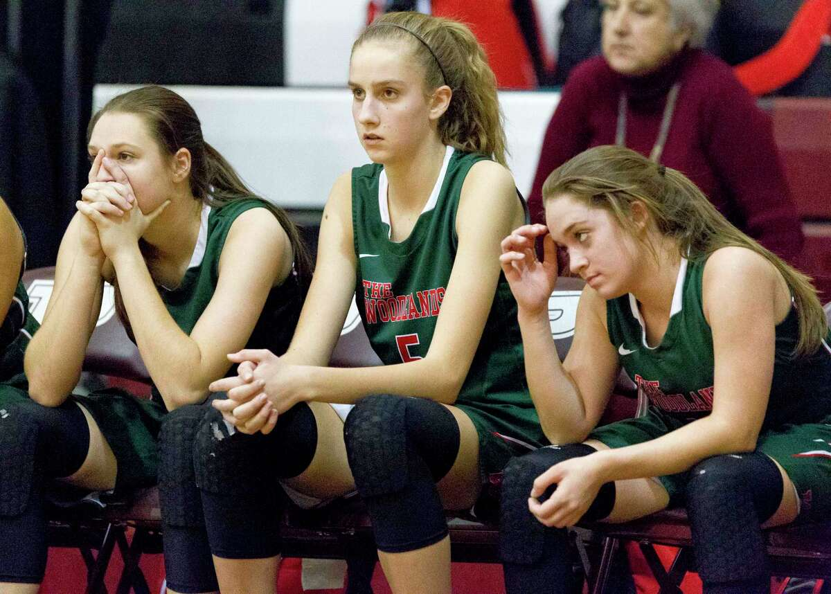 The Woodlands players are seen on the bench in the closing seconds of the fourth quarter of a Region II-6A bi-district playoff game at Palestine High School, Tuesday, Feb. 13, 2018, in Palestine.