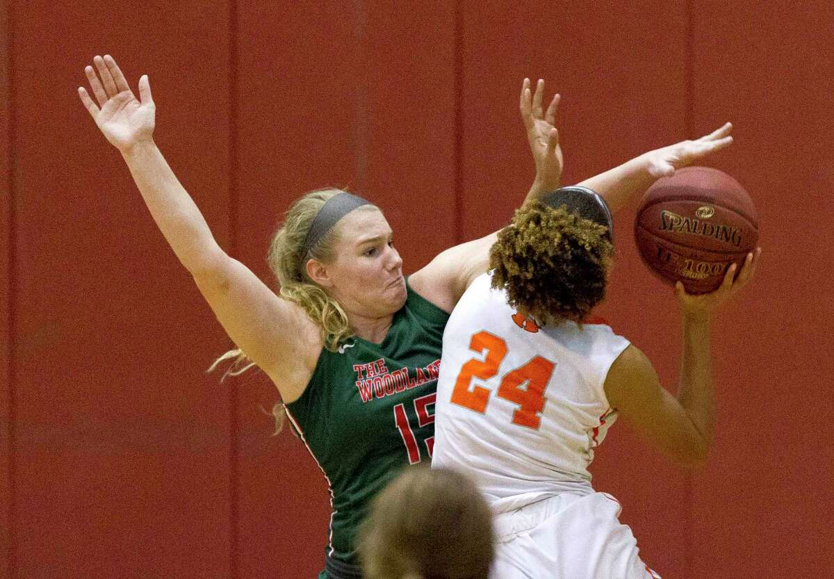 The Woodlands forward Madison Morton (15) blocks a shot by Rockwall center Faith Mason-Vestal (24) during the third quarter of a Region II-6A bi-district playoff game at Palestine High School, Tuesday, Feb. 13, 2018, in Palestine.