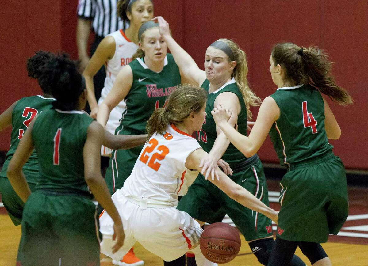 Rockwall guard Emma Stelzer (22) is surrounded by The Woodlands defense as she loses control of the ball during the third quarter of a Region II-6A bi-district playoff game at Palestine High School, Tuesday, Feb. 13, 2018, in Palestine.