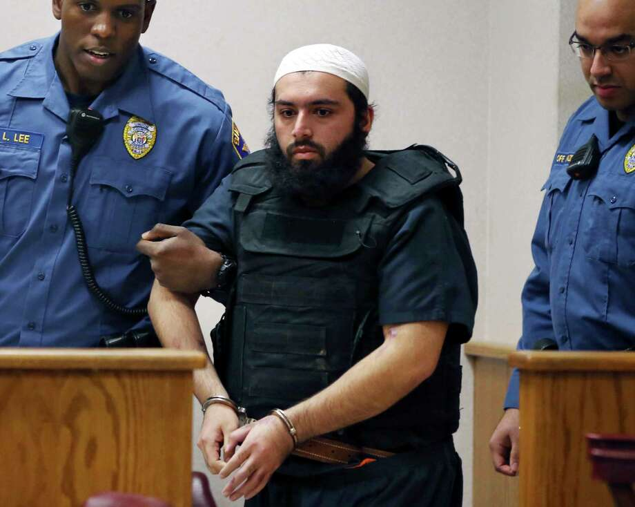 FILE - In this Dec. 20, 2016, file photo, Ahmad Khan Rahimi, center, is led into court in Elizabeth, N.J. Rahimi, who set off small bombs on a New York City street and at a charity race in New Jersey, is set to be sentenced to a mandatory term of life in prison. He is scheduled to be sentenced Tuesday, Feb. 13, 2018, by a federal judge in Manhattan. (AP Photo/Mel Evans, File) Photo: Mel Evans, STF / Copyright 2016 The Associated Press. All rights reserved.