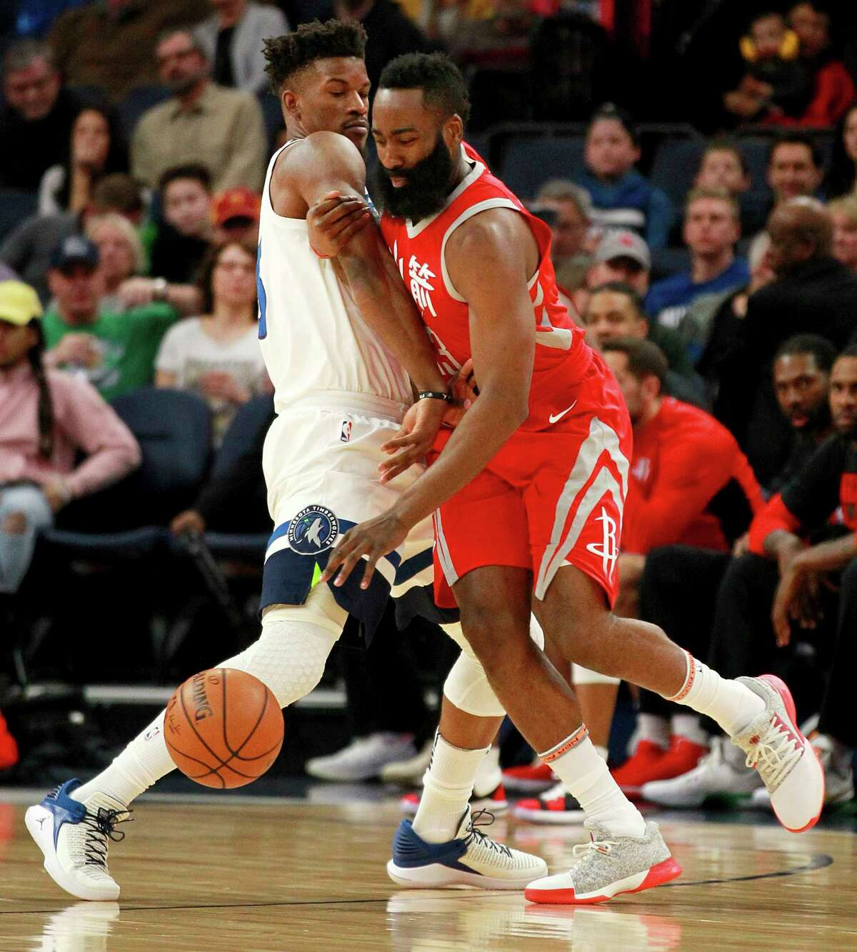 Minnesota Timberwolves forward Jimmy Butler, left, defends against Houston Rockets guard James Harden during the first quarter of an NBA basketball game Tuesday, Feb. 13, 2018, in Minneapolis. (AP Photo/Andy Clayton-King)
