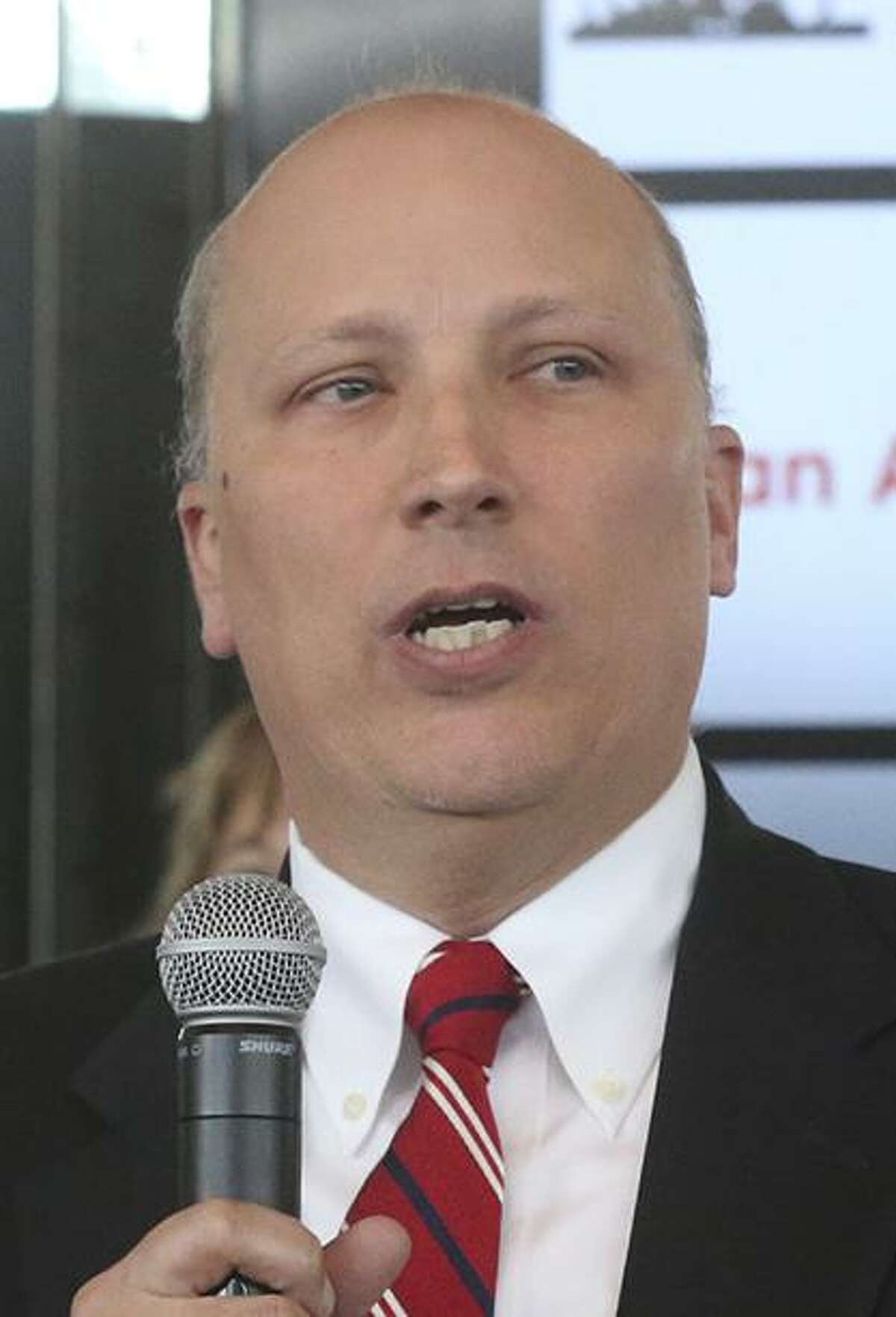 Congressional District 21 candidate Chip Roy (foreground, holding microphone) speaks Thursday January 11, 2018 at the Old San Francisco Steakhouse during a forum held during a meeting of the San Antonio Republican Women. The forum introduced 15 candidates running for the seat held in Congressional District 21 held by Representative Lamar Smith.