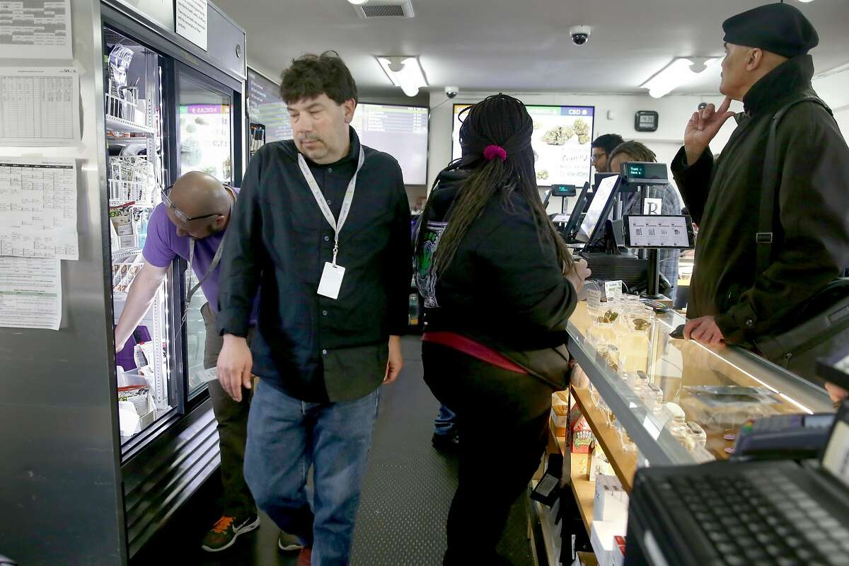 Dispensary specialist Russell Tenopsky helps a customer at Berkeley Patients Group, the city''s oldest dispensary,