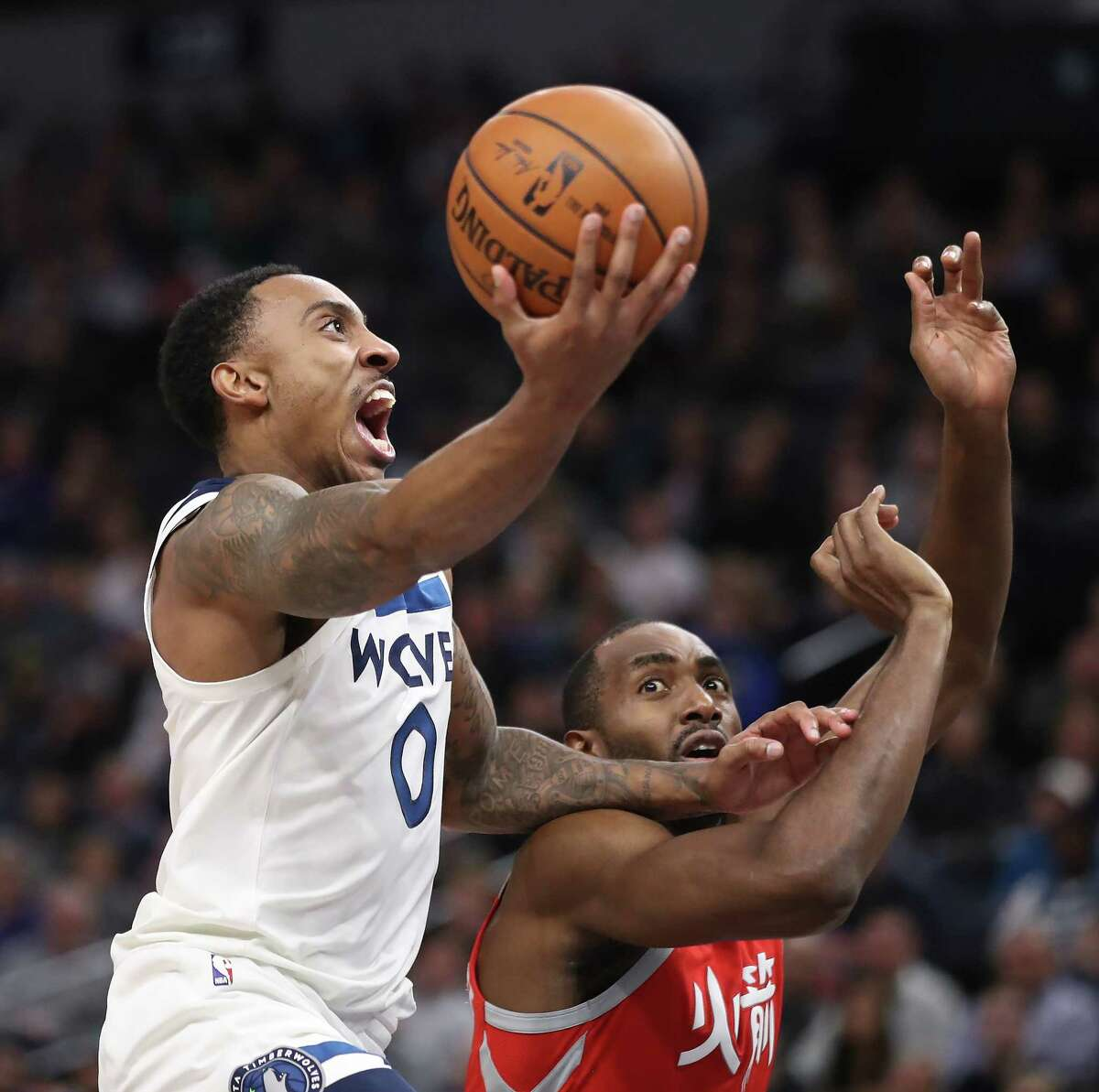 The Minnesota Timberwolves' Jeff Teague (0) scores over the Houston Rockets' Luc Mbah a Moute in the first half at Target Center in Minneapolis on Tuesday, Feb. 13, 2018.