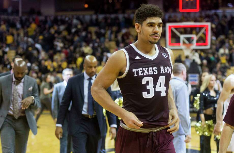 Texas A&M's Tyler Davis walks off the court with his team after they lost 62-58 to Missouri in an NCAA college basketball game Tuesday, Feb. 13, 2018, in Columbia, Mo. (AP Photo/L.G. Patterson) Photo: L.G. Patterson, Associated Press / FR23535 AP