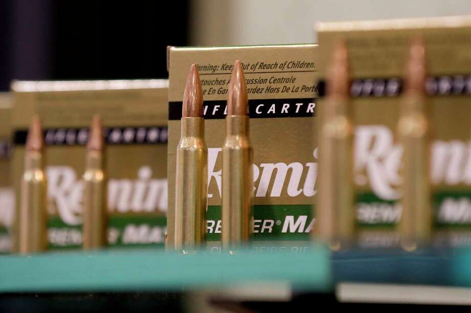 FILE - In this Jan. 15, 2013, file photo, Remington rifle cartridges are displayed at the 35th annual SHOT Show in Las Vegas. Remington, the gunmaker beset by falling sales and lawsuits tied to the Sandy Hook Elementary School massacre, said Monday, Feb. 12, 2018, that it has reached a financing deal that would allow it to continue operating as it files for Chapter 11 bankruptcy protection. (AP Photo/Julie Jacobson, File) Photo: Julie Jacobson / Copyright 2018 The Associated Press. All rights reserved.