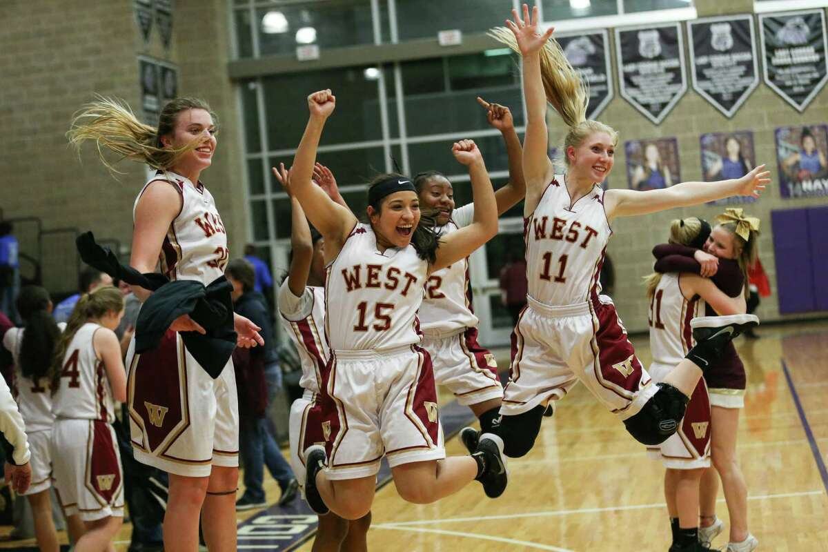 Lady Mustangs leap into the air for a photo after winning the girls basketball game against Pflugerville Connally on Tuesday, Feb. 13, 2018, at College Station High School. (Michael Minasi / Houston Chronicle)
