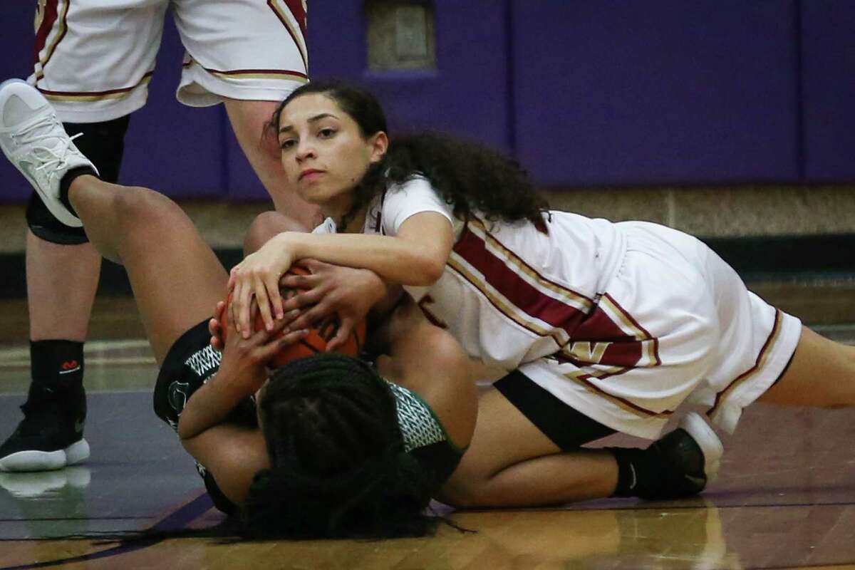 Magnolia WestÂ?'s Monyca Weathersby (13) battle for possession of the ball with a Pflugerville Connally defender during the girls basketball game on Tuesday, Feb. 13, 2018, at College Station High School. (Michael Minasi / Houston Chronicle)