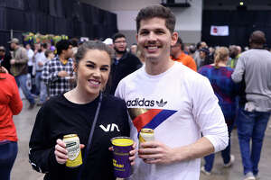Celina Cormier and Gunner Hansen at the Taste of the Triangle at the Beaumont Civic Center on Tuesday night. The annual event is a fundraiser for the Sabine Area Restaurant Association.   Photo taken Tuesday 2/13/18 Ryan Pelham/The Enterprise