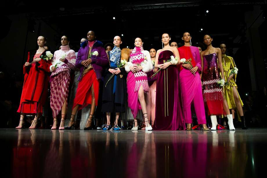 Models on the silent runway finale at the Prabal Gurung fashion show at Spring Studios on Sunday, Feb. 11, 2018, during New York Fashion Week. The models are carrying white roses, a symbol of the #MeToo movement against sexual harassment. #MeToo founder Tarana Burke was seated in the front row. Photo: Chase Gaewski, TNS