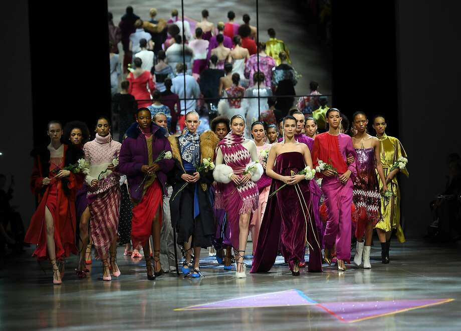 Models walk the runway for Prabal Gurung carrying white roses for the #MeToo movement during New York Fashion Week. Photo: ANGELA WEISS, AFP/Getty Images