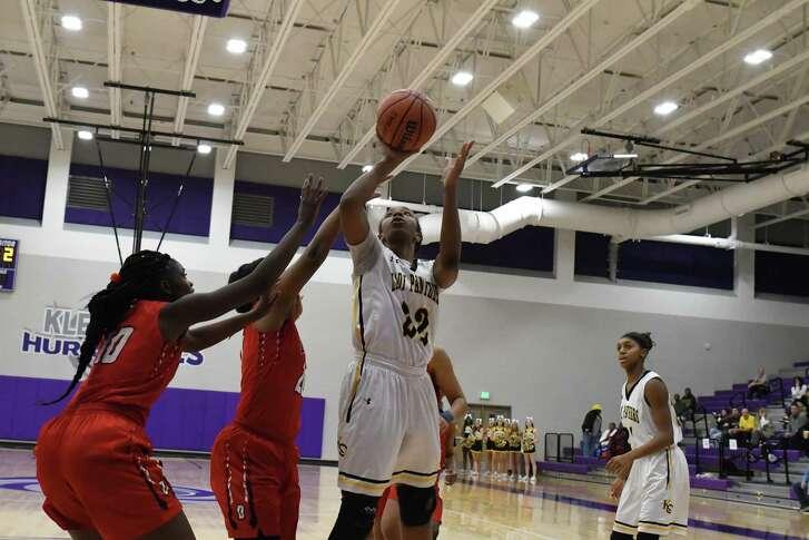 Klein Oaks (22) Elizabeth Jones scores a fast break lay up basket. Against Davis.