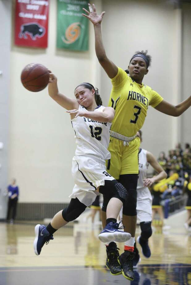 East Central's Nalyssa Smith (03) defends against O'Connor's Natalie McCoy (12) in Region IV Bi-District girls basketball at the Alamo Convocation Center on Tuesday, Feb. 13, 2018. East Central defeated O'Connor, 55-44. (Kin Man Hui/San Antonio Express-News) Photo: Kin Man Hui, Staff / San Antonio Express-News / ©2018 San Antonio Express-News
