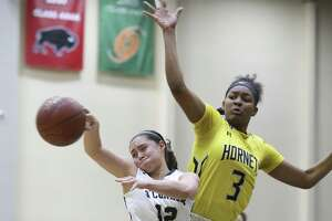 East Central's Nalyssa Smith (03) defends against O'Connor's Natalie McCoy (12) in Region IV Bi-District girls basketball at the Alamo Convocation Center on Tuesday, Feb. 13, 2018. East Central defeated O'Connor, 55-44. (Kin Man Hui/San Antonio Express-News)