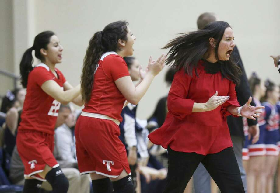 Taft basketball coach Kelli Goble (center) gets pumped up with her team's play against Smithson Valley in Region IV Bi-District girls basketball at the Alamo Convocation Center on Tuesday, Feb. 13, 2018. (Kin Man Hui/San Antonio Express-News) Photo: Kin Man Hui, Staff / San Antonio Express-News / ©2018 San Antonio Express-News