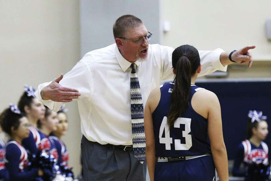 Smithson Valley basketball coach David Farber talks to Leesha Fross (43) during the game against Taft in Region IV Bi-District girls basketball at the Alamo Convocation Center on Tuesday, Feb. 13, 2018. Smithson Valley defeated Taft, 50-46. (Kin Man Hui/San Antonio Express-News) Photo: Kin Man Hui, Staff / San Antonio Express-News / ©2018 San Antonio Express-News