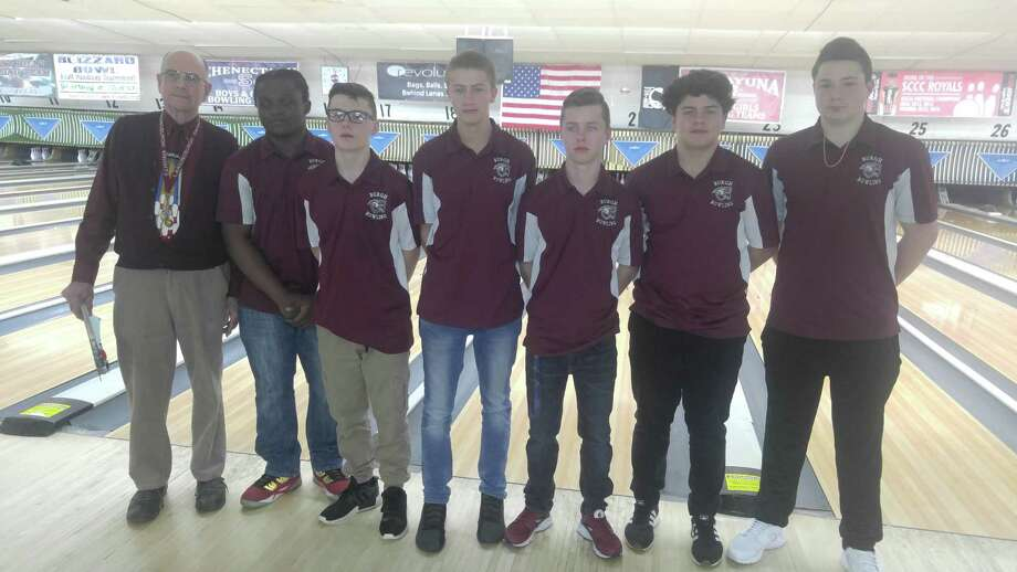 Members of the Section II Class B bowling champion Lansinburgh Knights (from left): coach Roland Blanchet, Johnnie King, Devyn Riffelbach, Codi Genthner, Jack Stevens, Mike Connally and Grant Lanstrup. Lansingburgh won its 10th Class B title Tuesday, Feb. 13, 2018, at Boulevard Bowl in Schenectady. (Pete Dougherty/Times Union)