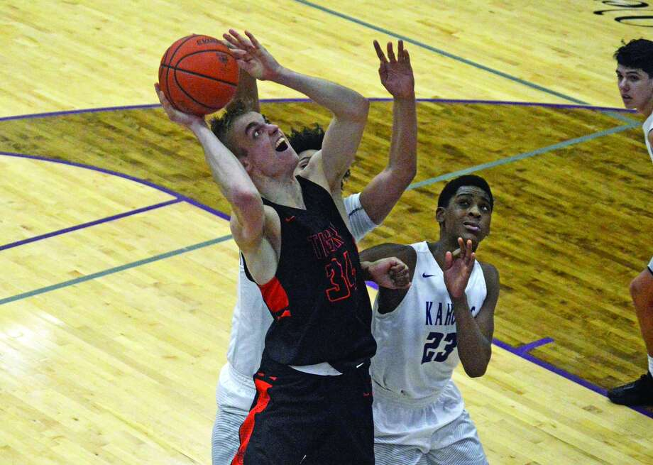 Edwardsville senior forward Caleb Strohmeier, front, goes up for a shot in traffic during the third quarter of Tuesday's Southwestern Conference game against Collinsville.