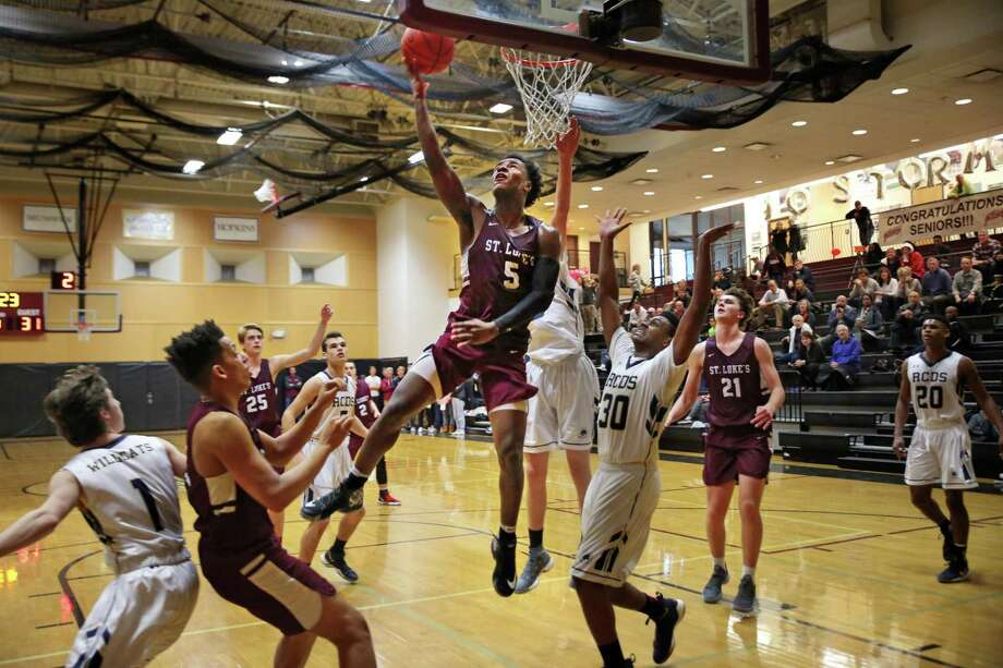 St. Luke's senior Jonas Harper goes up for a shot against Rye Country Day School. Photo: Contributed Photo / Desiree Smock 2018