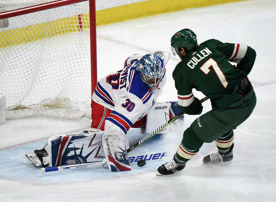 New York Rangers goalie Henrik Lundqvist (30), of Sweden, stops a shot by Minnesota Wild center Matt Cullen (7) during the third period of an NHL hockey game Tuesday, Feb. 13, 2018, in St. Paul, Minn. Minnesota won 3-2. (AP Photo/Craig Lassig) Photo: Craig Lassig / FR52664 AP
