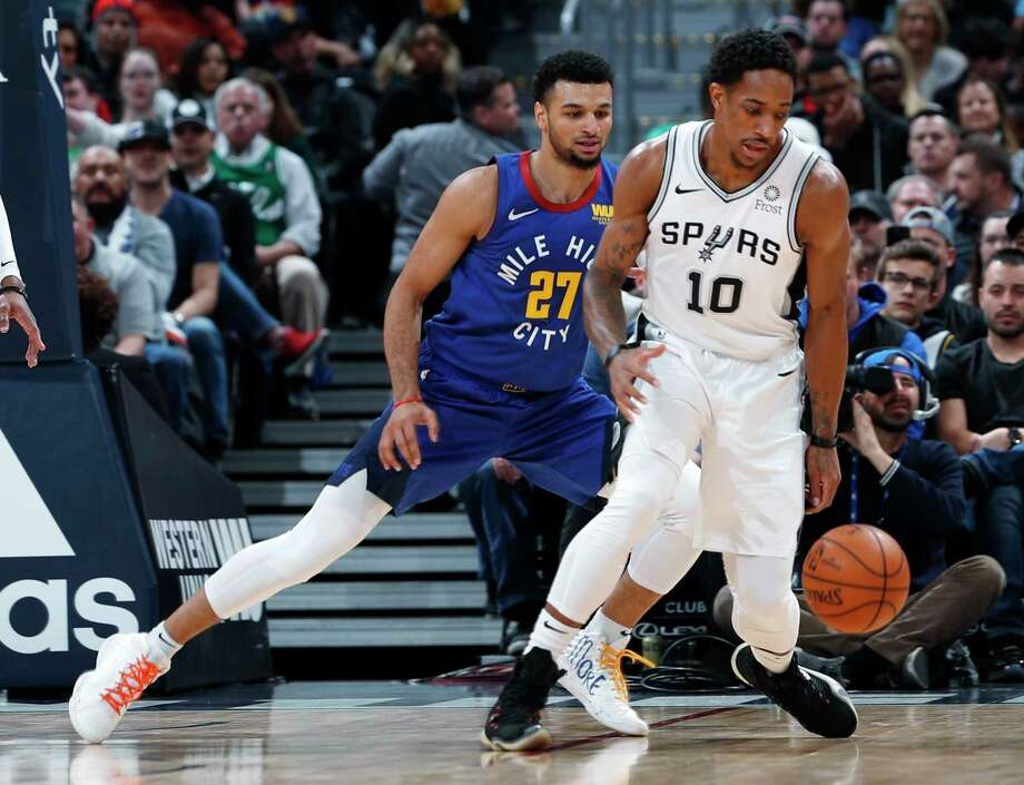 San Antonio Spurs guard Patty Mills, left, passes the ball as Denver Nuggets guard Jamal Murray defends during the first half of an NBA basketball game Friday, Feb. 23, 2018, in Denver. (AP Photo/David Zalubowski) Photo: David Zalubowski, Associated Press / Copyright 2018 The Associated Press. All rights reserved.