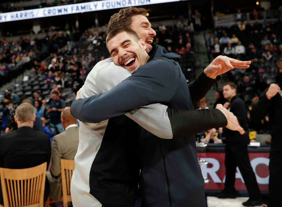 Denver Nuggets forward Juan Hernangomez, front, hugs San Antonio Spurs center Pau Gasol, both of Spain, as the teams warm up before the first half of an NBA basketball game Friday, Dec. 28, 2018, in Denver. (AP Photo/David Zalubowski) Photo: David Zalubowski, Associated Press / Copyright 2018 The Associated Press. All rights reserved.