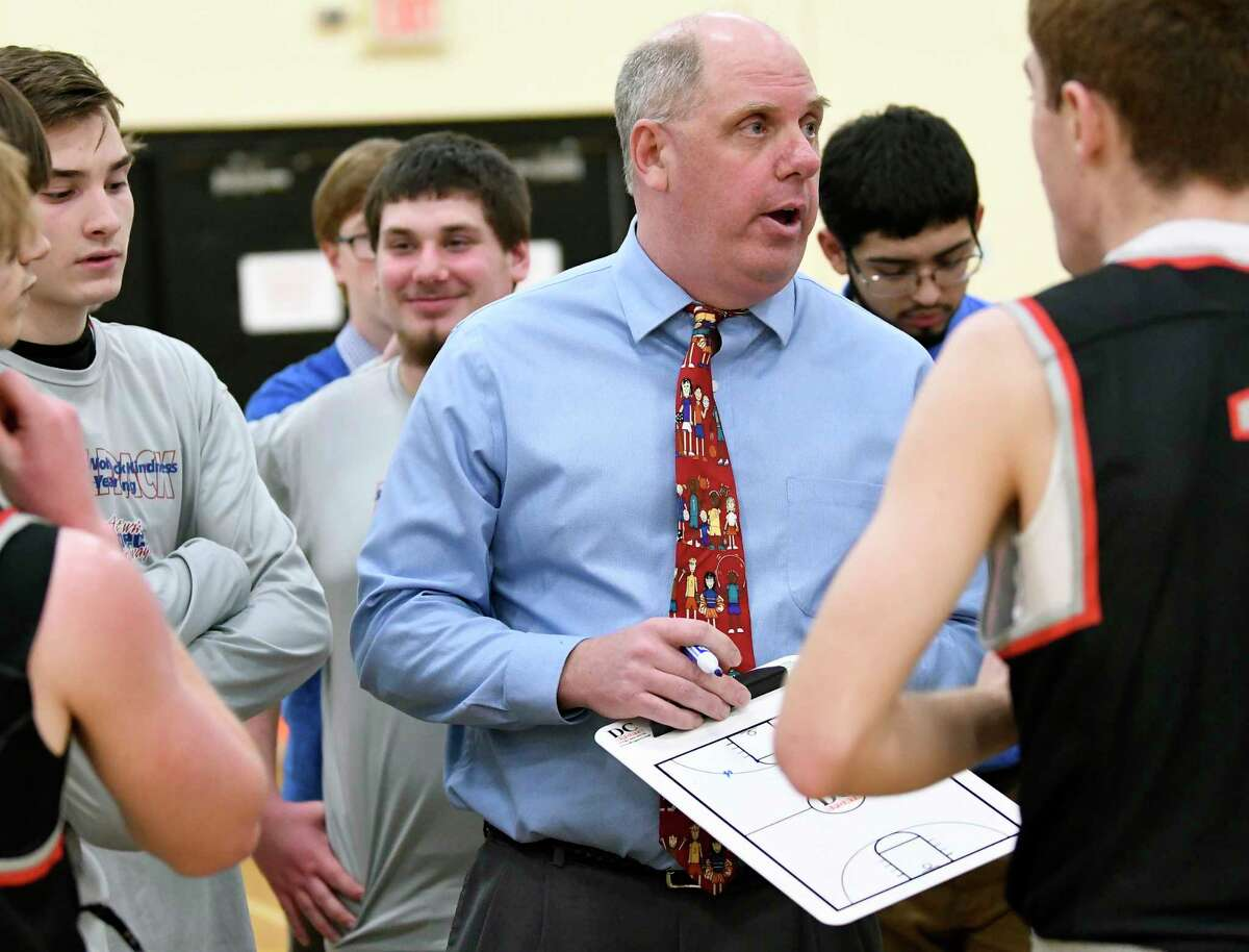 Oppenheim-Ephratah St. Johnsville head coach Jason Brundage instructs his players against Notre Dame Bishop Gibbons during a boys high school basketball game Tuesday, Feb. 13, 2018, in Johnstown, N.Y. (Hans Pennink / Special to the Times Union)