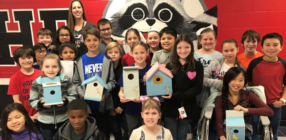 Fourth-graders at Woodland Hills Elementary School hold the birdhouses they designed for a math project. Photo: Courtesy Of Humble ISD