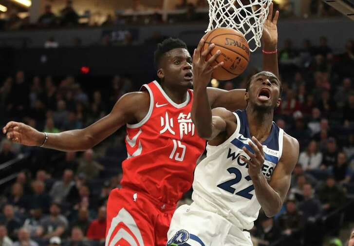 The Minnesota Timberwolves' Andrew Wiggins (22) puts up a shot against the Houston Rockets' Clint Capela (15) in the first half at Target Center in Minneapolis on Tuesday, Feb. 13, 2018. (Jerry Holt/Minneapolis Star Tribune/TNS)