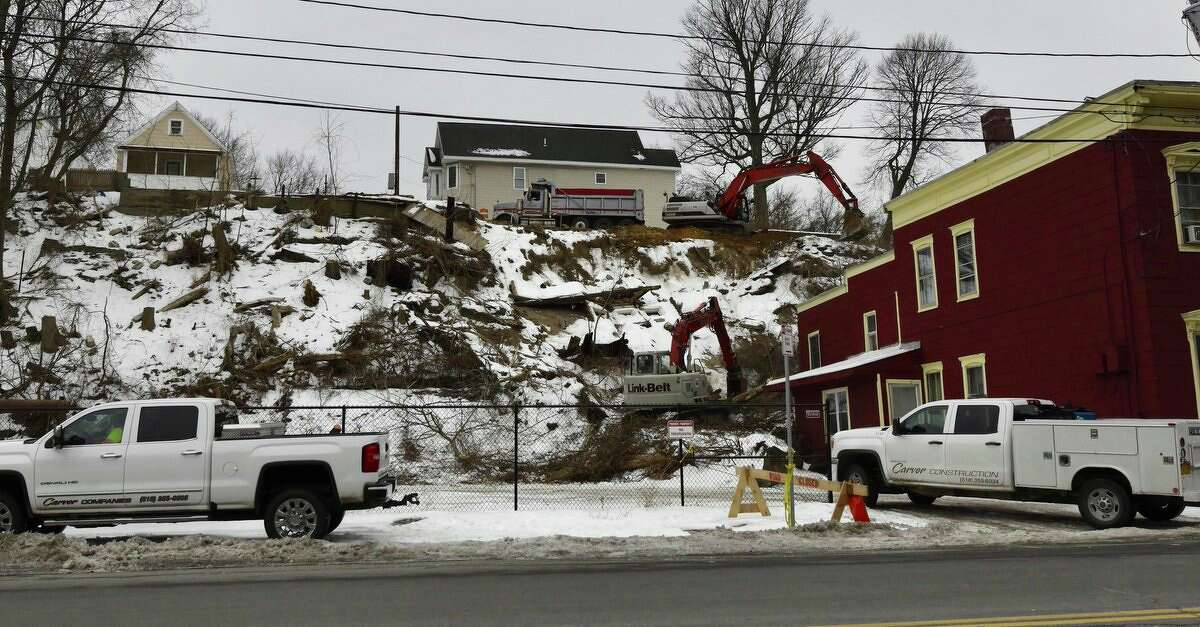 Work was underway Wednesday morning as construction workers and engineers tried to stabilize the hillside above Nott Terrace in Schenectady. Tons of soil, trees and stones slid onto a home on Nott Terrace on Jan. 28, 2018.