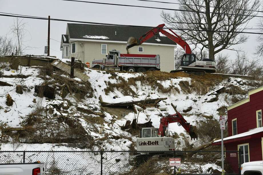 Work was underway Wednesday morning as construction workers and engineers tried to stabilize the hillside above Nott Terrace in Schenectady. Tons of soil, trees and stones slid onto a home on Nott Terrace on Jan. 28, 2018. Photo: Skip Dickstein / Times Union