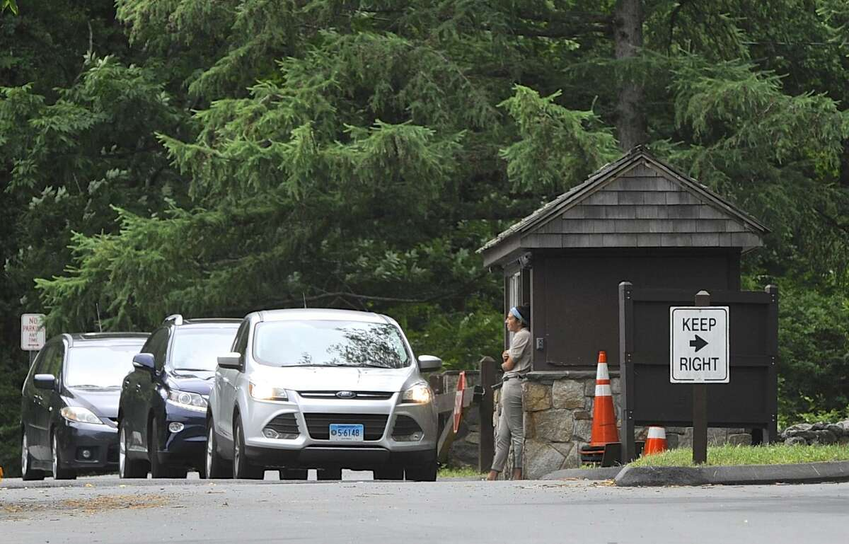 Cars line up at the entrance to Squantz Pond State Park, in New Fairfield, on the first day of the Fourth of July holiday weekend. Saturday, July 2, 2016, in New Fairfield, Conn.