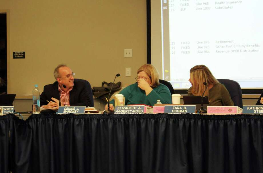 Darien school board member Dennis Maroney (left) discusses the budget with board chair Tara Ochman at a meeting in Darien, Conn. on Feb. 13, 2018. Photo: Erin Kayata / Hearst Connecticut Media / Darien News